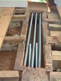 Steel High Tensile Rods inside a dug our carrier beam waiting for Structural Epoxy Resin to be poured
