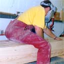 Sanding an enormous laminated beam