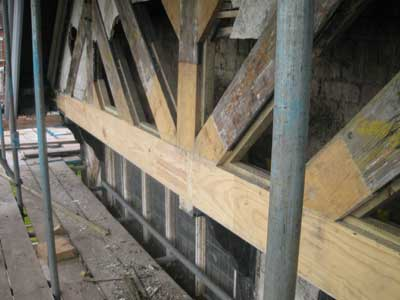 Multiple Timber Resin Splice repairs to a roof truss.